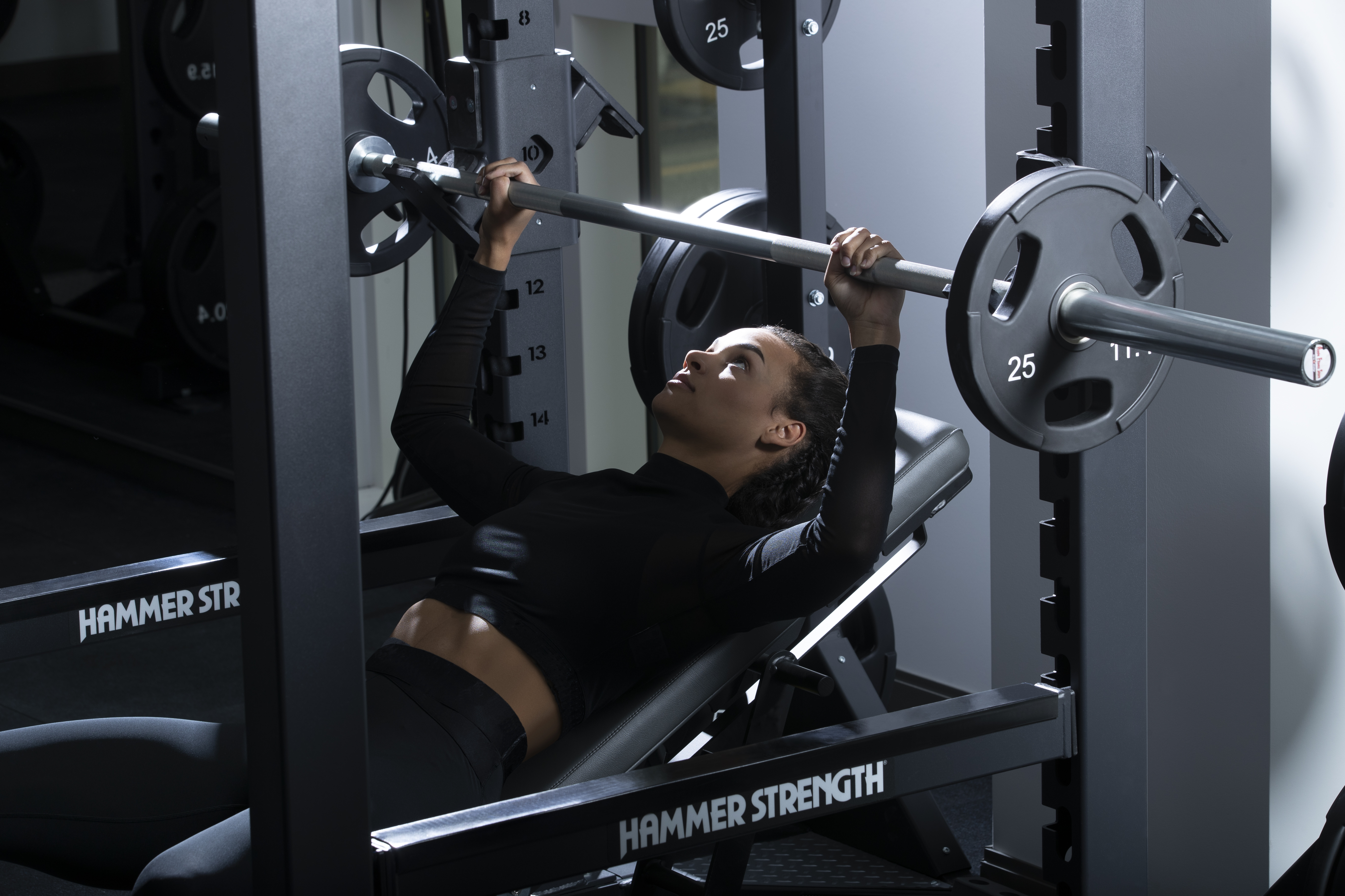Woman_Lifting_Bench_and_Power_Rack