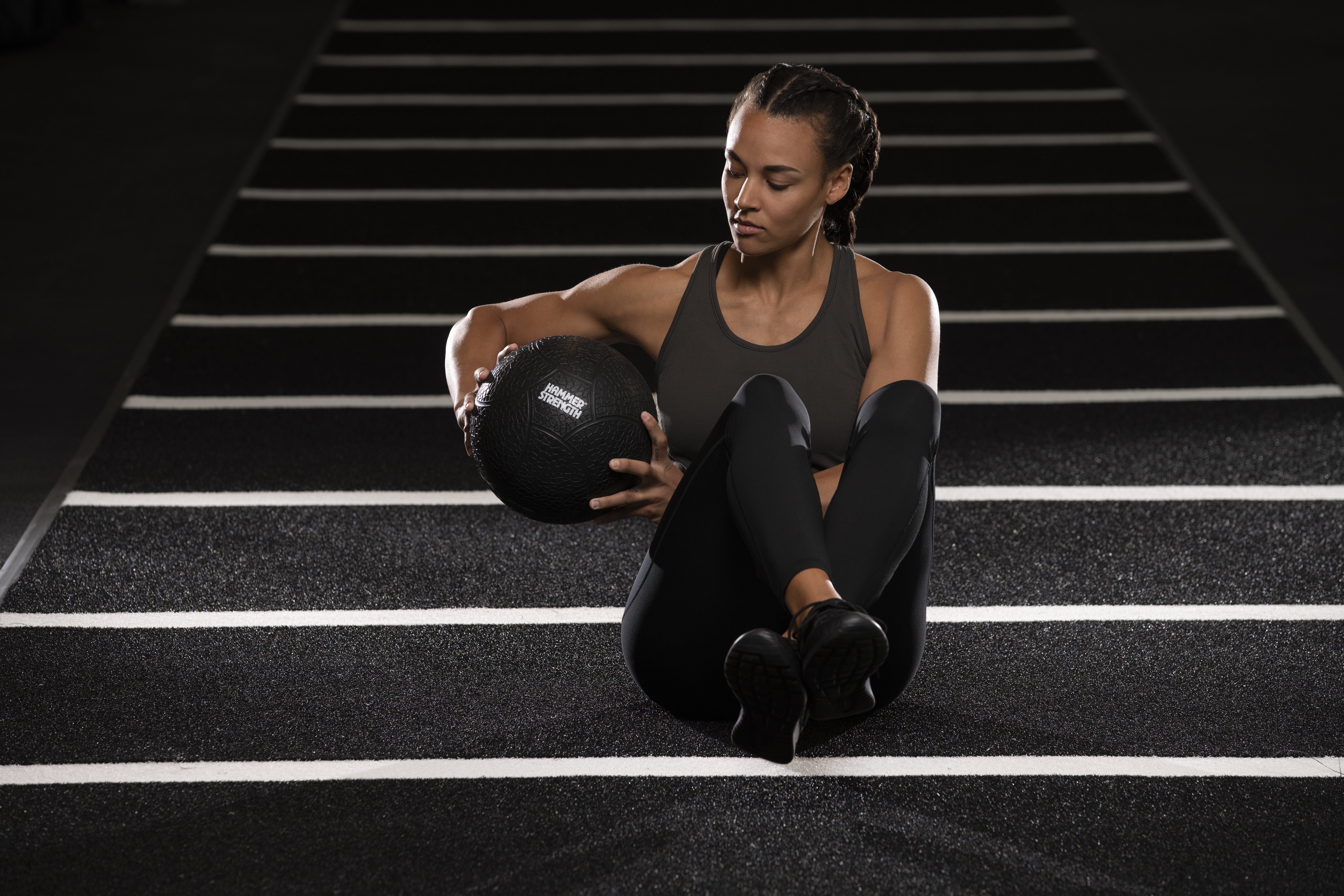 Woman_with_Medicine_Ball_on_Track